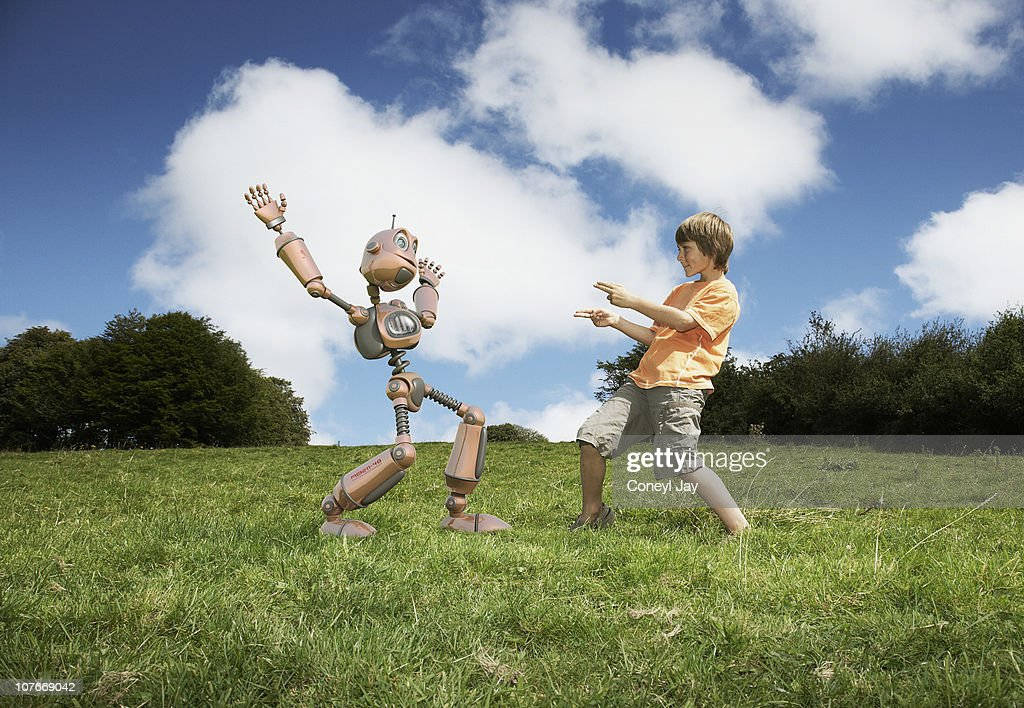 young boy with robot companion : Foto de stock