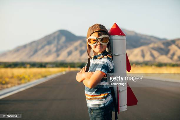 young boy with rocket pack - motivation stock pictures, royalty-free photos & images