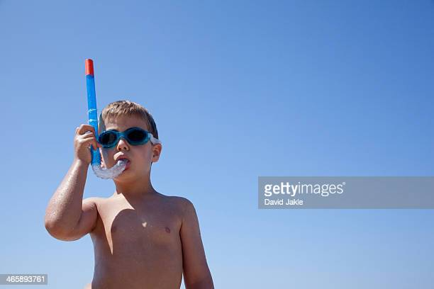 Young boy with snorkel and goggles