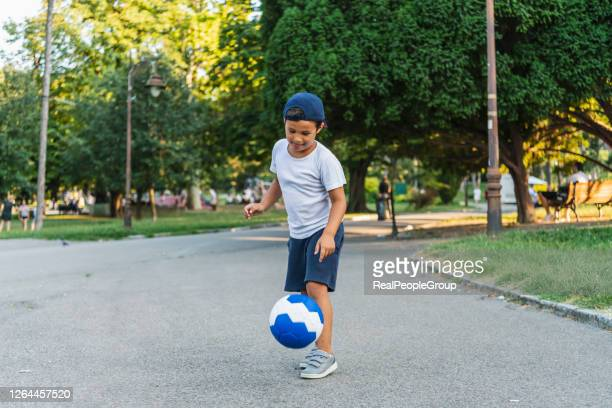 young boy with soccer outdoor - kicking stock pictures, royalty-free photos & images