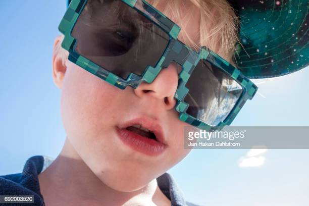 Young boy with sunglasses