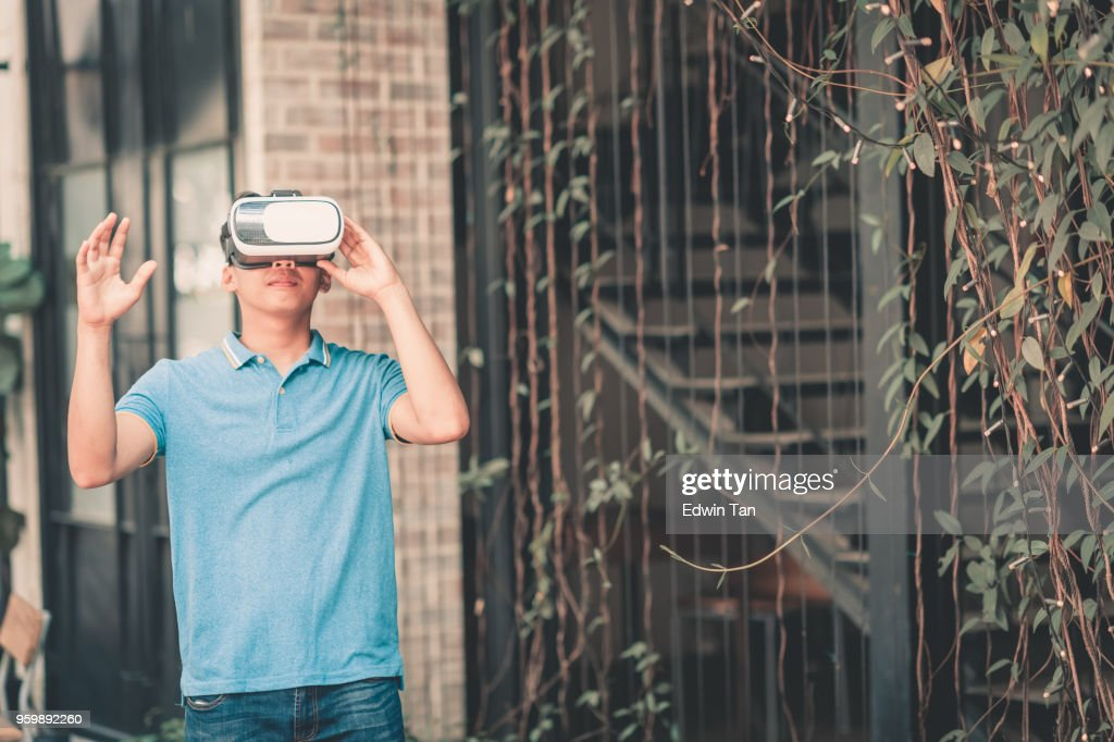young boy with VR headset playing and exploring : Stock Photo