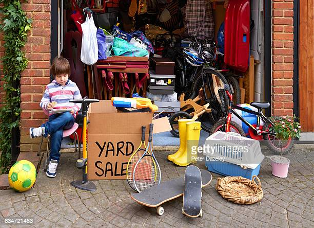 young boy with yard sale - garage sale stock pictures, royalty-free photos & images