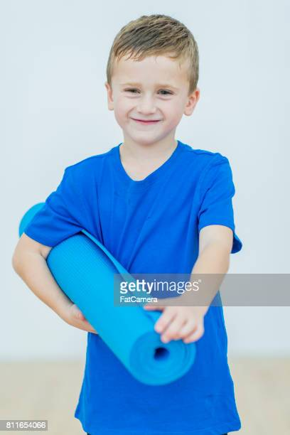 Young Boy With Yoga Mat