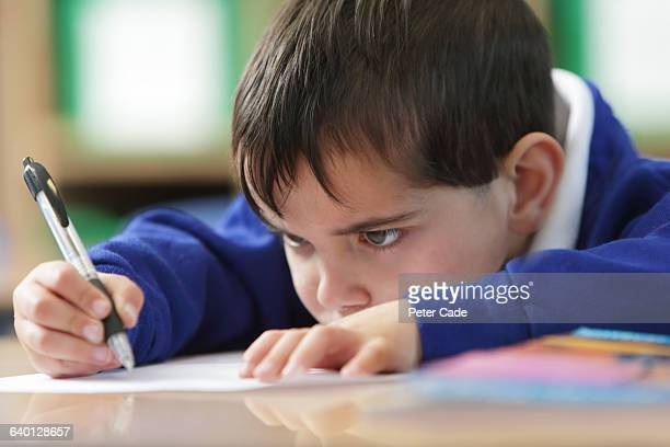 Young boy working in classroom