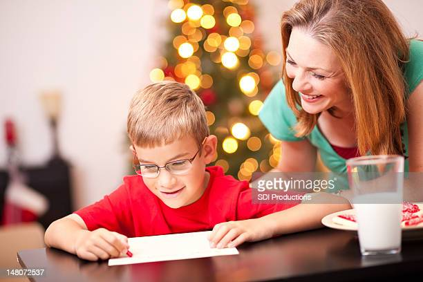 Young Boy Writing Note to Santa on Christmas Eve