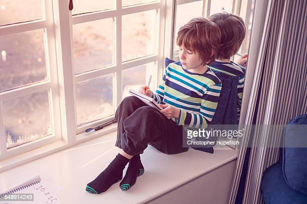 young boy writing - handwriting stock pictures, royalty-free photos & images