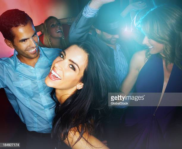 Young boys and girls enjoying at nightclub