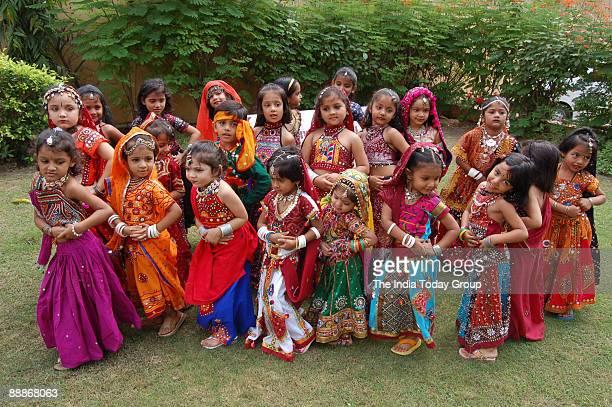 Young boys and Girls performing Dandia at Navratri Festival in Ahmedabad Gujarat India