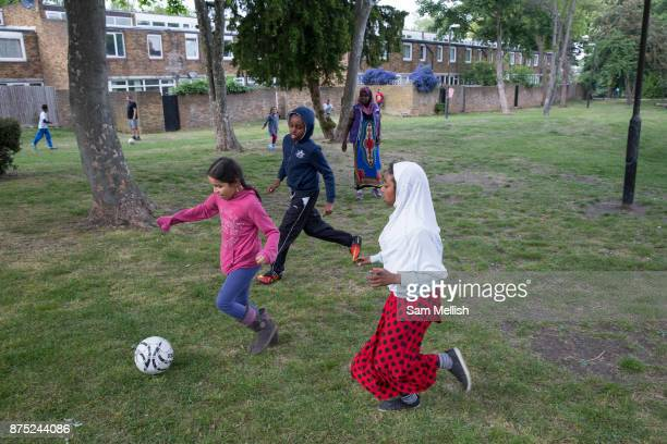 Young boys and girls play football at Cressingham Gardens estate on 11th May 2017 in South London United Kingdom Cressingham Gardens is a council...