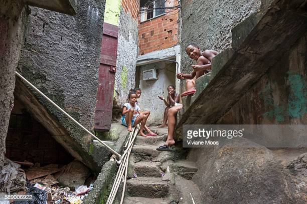 Young boys and girls playing in the narrow steep streets Water tubing runs everywhere trying to bring running water to home taps In Rocinha the...