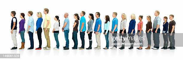 young boys and girls standing in a line - lining up stock pictures, royalty-free photos & images