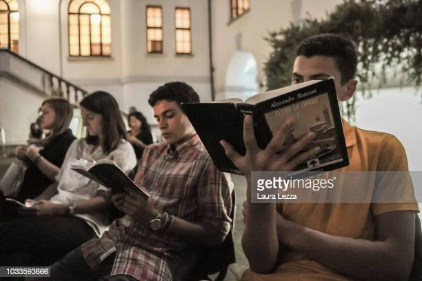 Young boys and girls take part in the collective 24 hour Marathon Reding of the I Promessi Sposi novel by Alessandro Manzoni during night time at...
