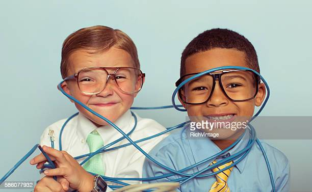 Young Boys and IT Professionals Smile Through Wire