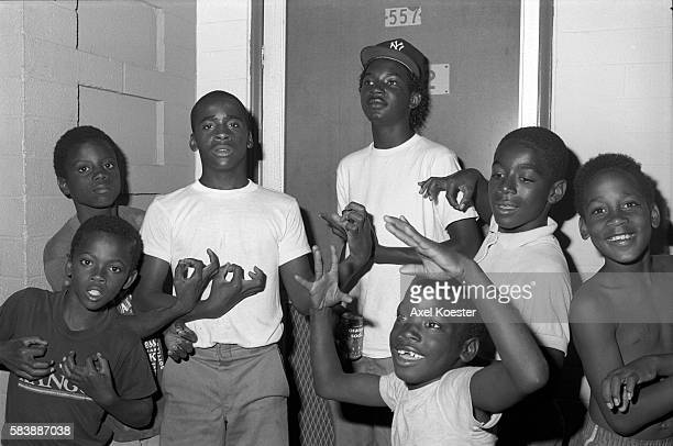 Young boys and members of the Grape Street Crip throwing their signature 'G' and 'W' hand signs The Grape Street Watts Crips are a mostly African...