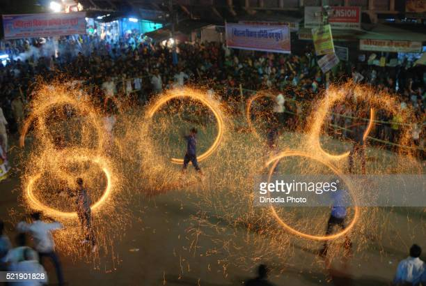 young boys burning firework on the occasion of dushera, jodhpur, rajasthan, india - saraswati puja stock pictures, royalty-free photos & images