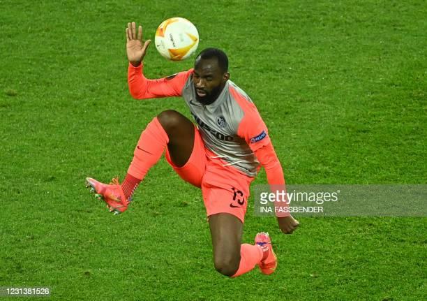 Young Boys' Cameroon midfielder Moumi Ngamaleu plays the ball during the UEFA Europa League last-32, 2nd-leg football match Bayer 04 Leverkusen v...