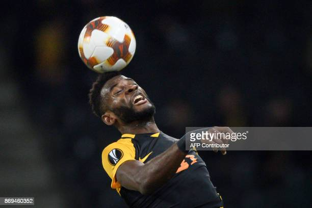 Young Boys' Cameroonian forward JeanPierre Nsame heads the ball during the UEFA Europa League Group B football match between Young Boys and Dynamo...