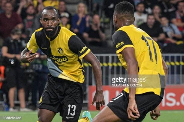 Young Boys' Cameroonian midfielder Nicolas Moumi Ngamaleu celebrates after scoring a goal with Young Boys' US forward Jordy Siebatcheu Pefok during...