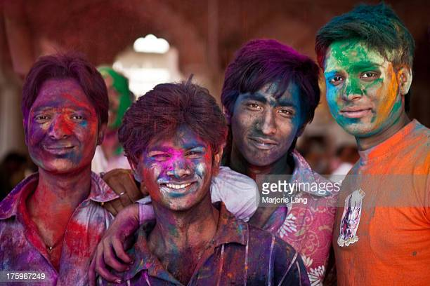 CONTENT] Young boys celebrating Holi festival on march 1st 2010 with colorful powders all over their faces inside the Govinda temple of Jaipur...