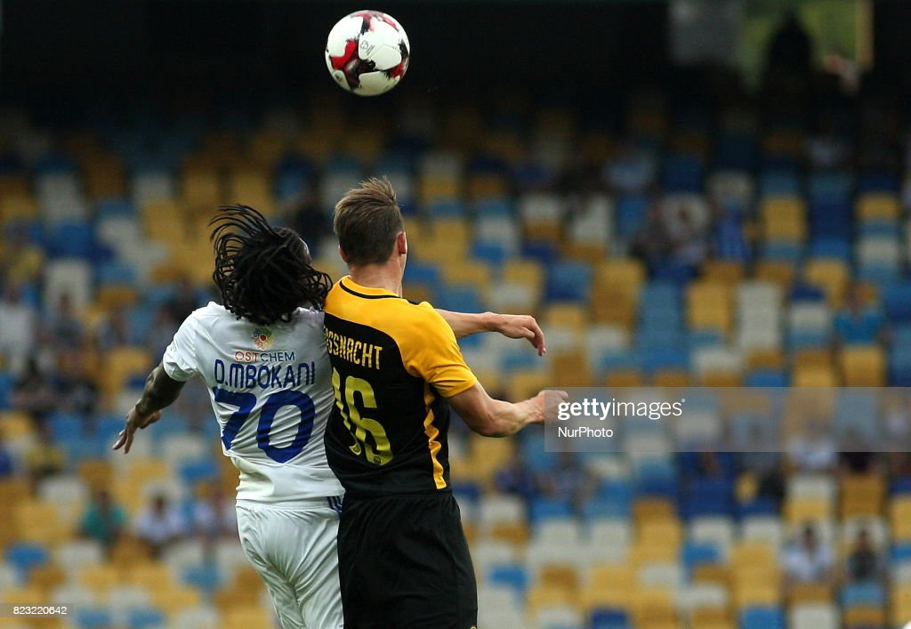 Young Boys' Christian Fassnacht, right, and Dynamo Kiev's Mbokani, left, fight for the ball during the match of the third qualifying round of the Champions League between the teams of Dynamo Kiev and Young Boyes at the Olympic Stadium in Kiev. Ukraine, Wednesday, July 26, 2017