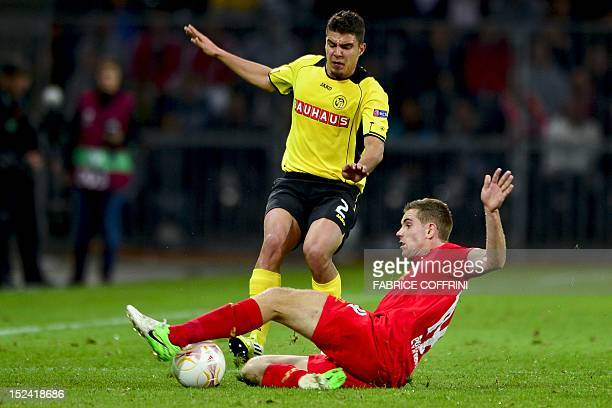Young Boys' defender Alexander Gonzalez vies for the ball with Liverpool's midfielder Jordan Henderson during the Europa League group A football...