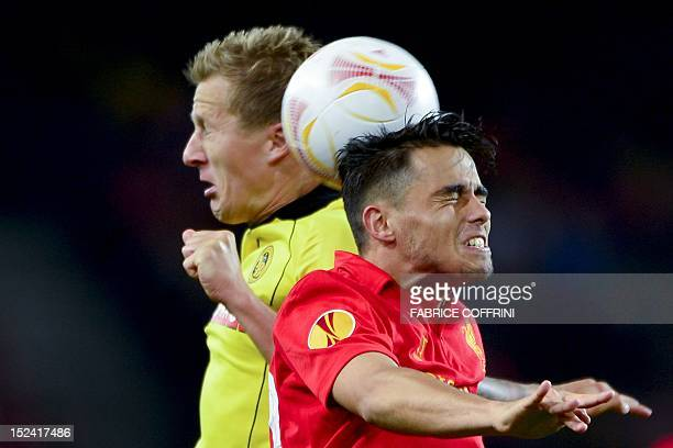 Young Boys' defender Christoph Spycher vies with Liverpool's forward Suso during an Europa League group A football match between Young Boys and...