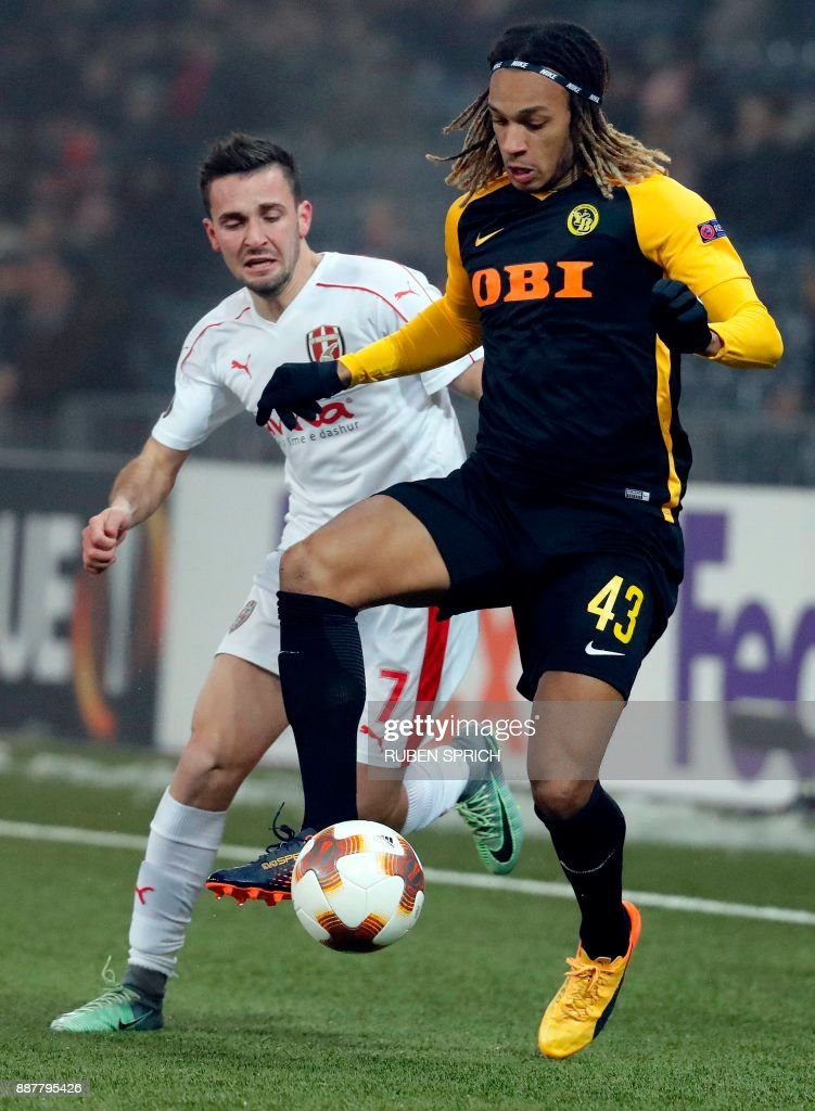 Young Boys' defender Kevin Mbabu (R) and Skenderbeu's midfielder Enis Gavazaj fight for the ball during the UEFA Europa League Group B football match between Young Boys and Skenderbeu at Stade de Suisse stadium in Bern on December 7, 2017. / AFP PHOTO / Ruben SPRICH