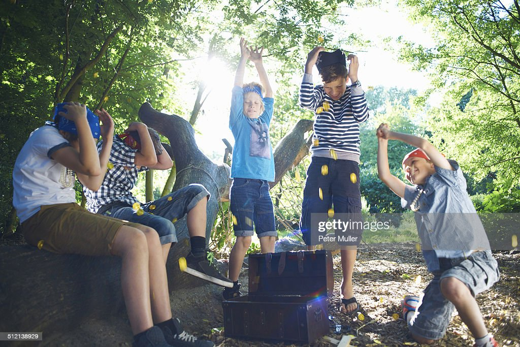 Young boys dressed as pirates with treasure chest : Stock Photo