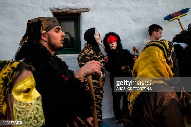 Young boys dressed in costumes take part in the Skyrian Carnival on the island of Skyros northeast of Athens on March 9 2019 In the celebrations of...