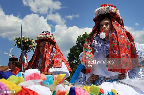 Young boys dressed in female traditional outfits sit on decorated horses on May 27 2012 in the village of Vlcnov south Moravia 80 km southeast of...