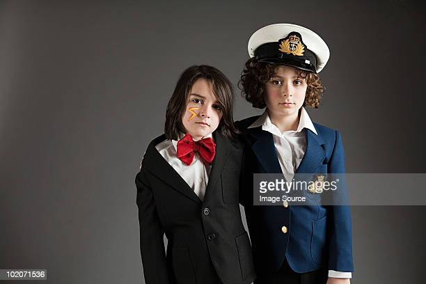 Young boys dressed up in sailor outfit and red bow tie