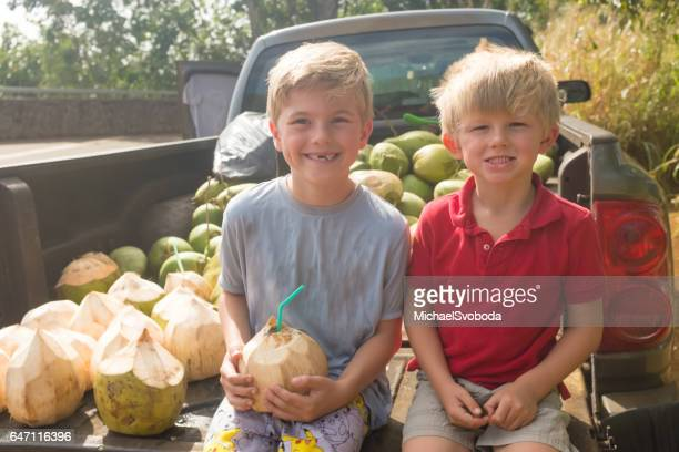 Young Boys Drinking Coconut Water