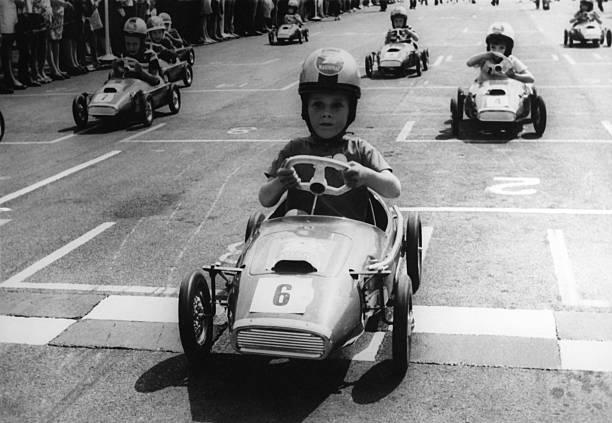 Young Boys Driving Racing Pedal Cars Wall Art