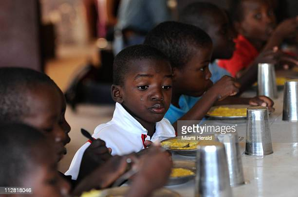 Young boys eat breakfast February 3 at the Good Shepherd orphanage in the Delmas neighborhood of PortauPrince Haiti