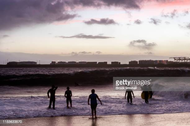 Young boys enjoy rare waves breaking inside Botany Bay on June 04 2019 in Sydney Australia The Bureau of Meteorology issued a severe weather warning...