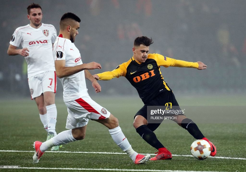 Young Boys' forward Pedro Teixeira (R) and Skenderbeu's defender Bajram Jashanica vie for the ball during the UEFA Europa League Group B football match between Young Boys and Skenderbeu at the Suisse Stadium on December 7, 2017 in Bern. / AFP PHOTO / Ruben SPRICH