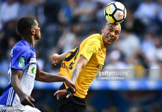 Young Boys' French forward Guillaume Hoarau heads a ball next to Lausanne's Portugese defender Elton Monteiro during the Swiss Super League football...