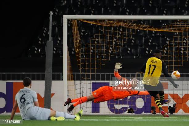 Young Boys' French forward Jordan Siebatcheu scores against Leverkusen during the UEFA Europa League round of 32 first leg football match between BSC...