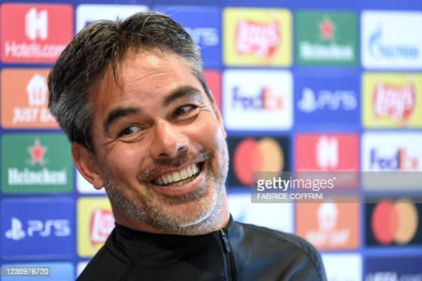 Young Boys' German coach David Wagner smiles during a press conference on the eve of the UEFA Champions League first round group F football match...