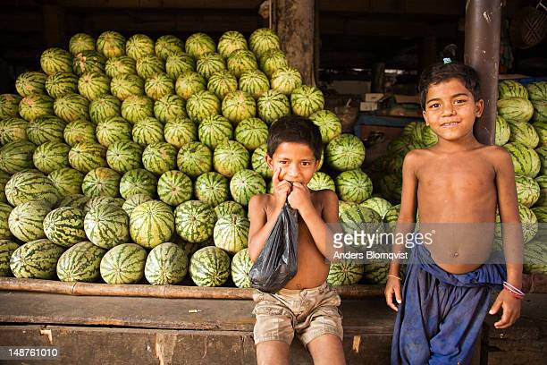Young boys guarding watermelons at Crawford Market.