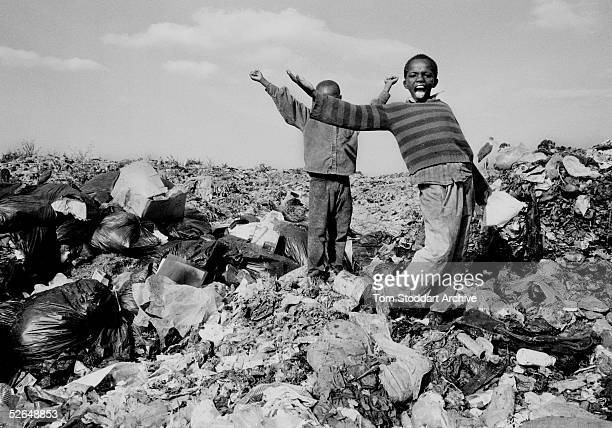 Young boys high on glue scavange for food on the Nairobi city garbage dump 500 children many of whom are HIV positive survive on the 30 tonnes of...