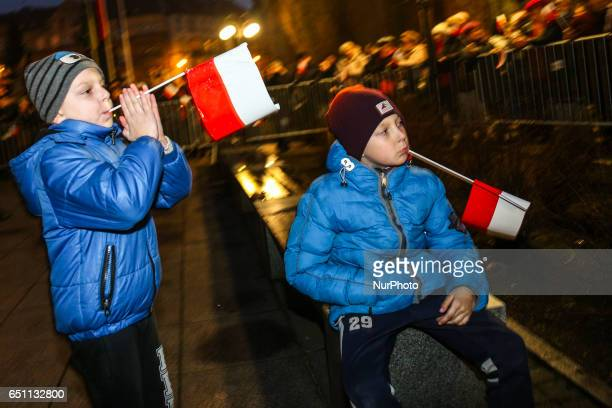 Young boys hold Polish flags during the visit of the President of Poland Andrzej Duda in Siemianowice Slaskie on March 9 2017