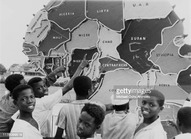 Young boys in Ghana point to a map of the African continent following the coup d'état which overthrew President Kwame Nkrumah, March 1966.