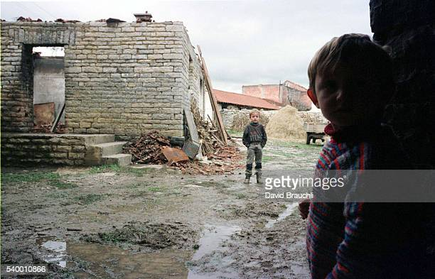 2 young boys in Iglarebo village Most of the family's farm was destroyed by Serb forces