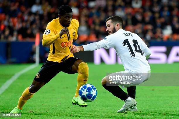 Young Boys' Ivorian forward Roger Assale challenges Valencia's Spanish defender Jose Luis Gaya Pena during the UEFA Champions League group H football...
