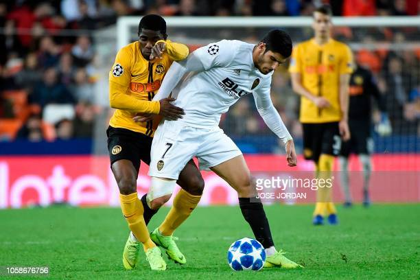 Young Boys' Ivorian forward Roger Assale challenges Valencia's Portuguese midfielder Goncalo Guedes during the UEFA Champions League group H football...