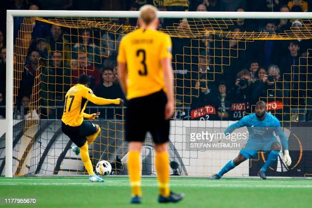 Young Boys' Ivorian forward Roger Assale scores a penalty kick during the Europa League Group G football match between BSC Young Boys and Feyenoord...