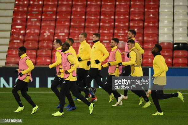 Young Boys' Ivorian forward Roger Assale Young Boys' Swiss defender Steve von Bergen Young Boys' Cameroonian midfielder Moumi Ngamaleu Young Boys'...