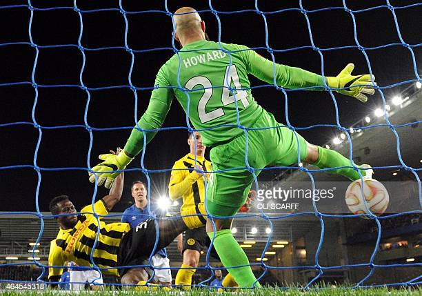 Young Boys' Ivorian midfielder Sekou Sanogo scores the 01 past Everton's US goalkeeper Tim Howard during the UEFA Europa League round of 32 second...